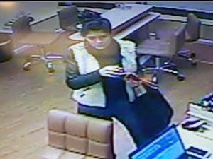 Woman caught on video passing off alleged counterfeit $100.