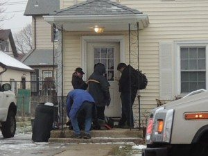 Police are investigating a Mineola shooting outside this Roslyn Road home this morning. (Photo by Rich Forestano)