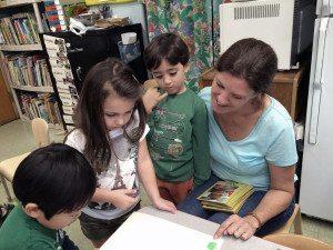 Ethan Gilbert and Daphne Mallios from Manhasset with teacher Mrs. Anne-Marie Pumo