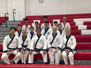 Students and instructors from Kwon's Karate in Manhasset after the recent black-belt test. Front row (from left): Master instructors D. Kwon, D. Estey, H.Y. Kwon, Z. Beg, E. Phillips. Middle row: C. Liu, D. Yoon, D. Barcelona, C. Yoon. Back row: A. Moy, M. Koek, J. De Haan, T. Moy, A. Carpentier.
