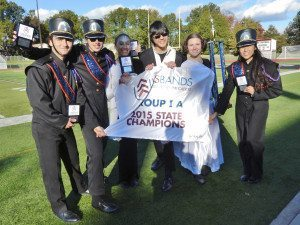 MHS Marching Band quartermasters Harry Petropoulos, Bryan Morrissey, Amanda Naccarato, drum majors Jeffrey Chin and Michelle Marcisak and quartermaster Christina Yoo celebrate the band's first place win at the NY State Championship on Oct. 18.