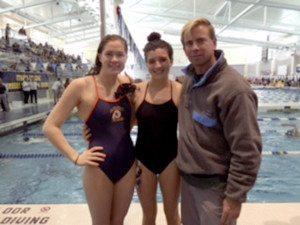 Manhasset longtime swimmers Kylie Mulholland and Grace Kenlon with Head Swim Coach Matt McGrane