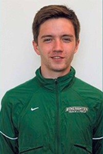 Tim Courts stands proudly after earning All-American honors in the 2K Steeplechase at the New Balance Outdoor National Track & Field Championships. Courts  represents the Bearcats this fall as a member of the cross country and track teams  at SUNY Binghamton.