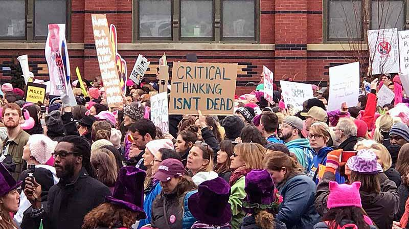 Marchers packed the streets of the nation's capital, many carrying creative signs and wearing pink cat-ear hats as symbol of unity.